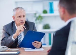 Man speaking to colleague